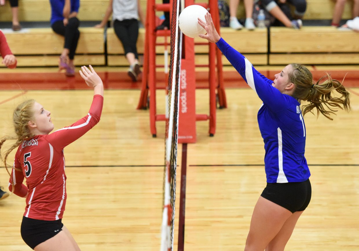 Moffat County High School's Morgan Lawton puts up a block for the Lady Bulldog volleyball team. An Outstanding Female Athlete nominee, Lawton was part of the volleyball, basketball and track and field teams this year.