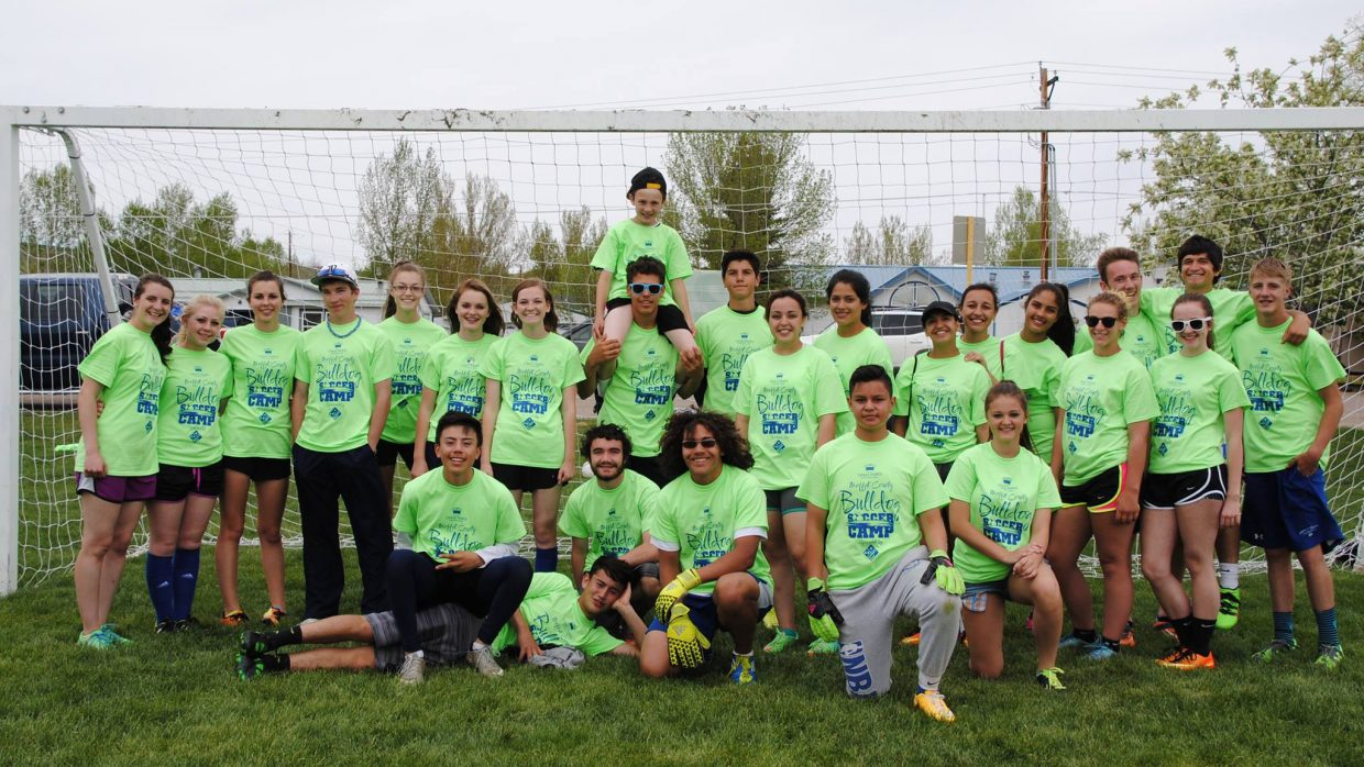 The members of the Moffat County High School boys and girls soccer teams gather for the Bulldog Soccer Camp Saturday at Woodbury Sports Complex, hosted by MCHS soccer and Craig Parks & Recreation. High school athletes and coaches helped instruct about 70 young players in the sport during the day.
