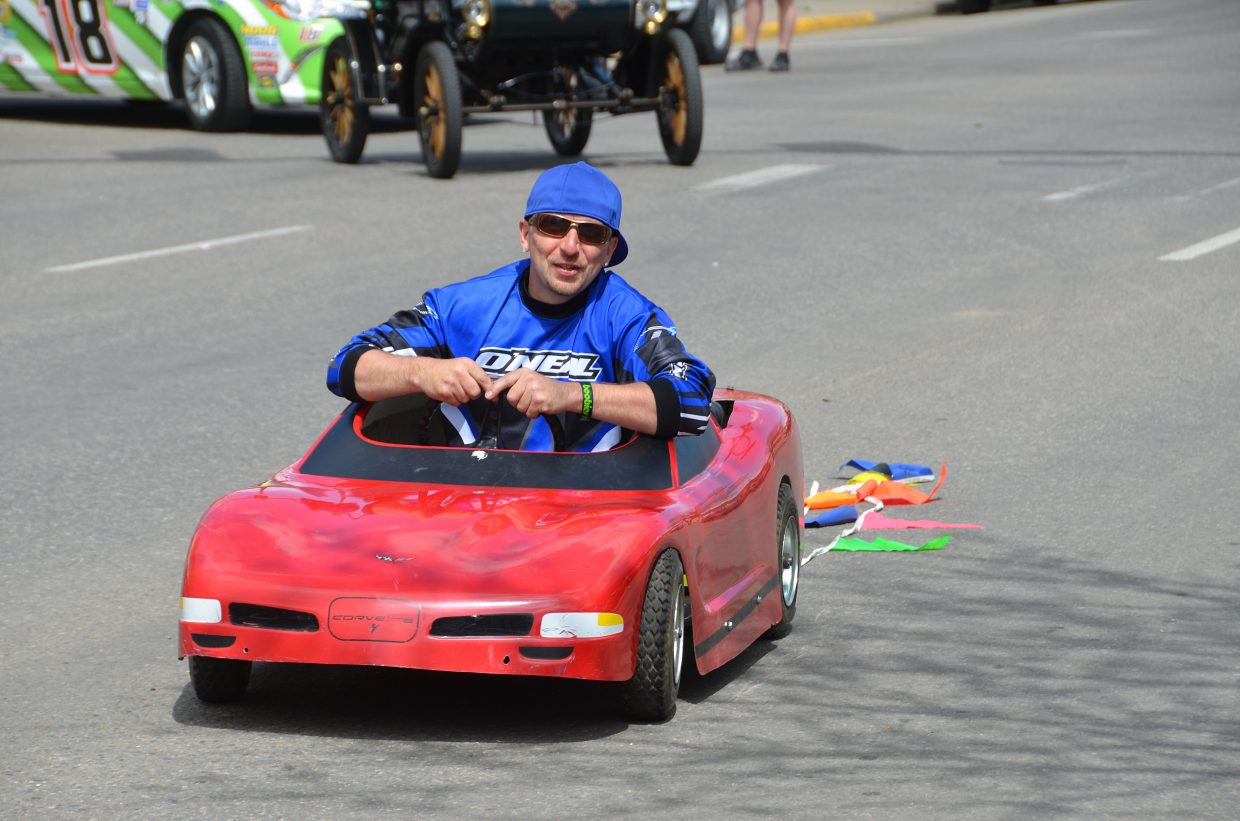 Jessie Merrick cruises around in a mini car at the Grand Olde West Days Parade held on Saturday afternoon.