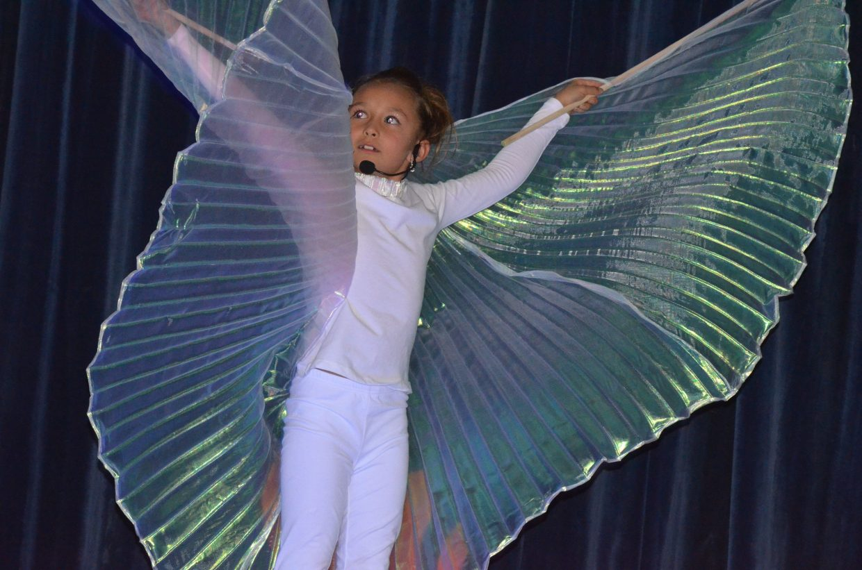 """Samantha Franklin spreads her wings as she sings """"Girl on Fire"""" during Studio BV's vocal performance recital, """"Light Up the Stage"""" May 13 in the Craig Middle School auditorium. Franklin performed multiple songs in the show, which featured young local singers."""