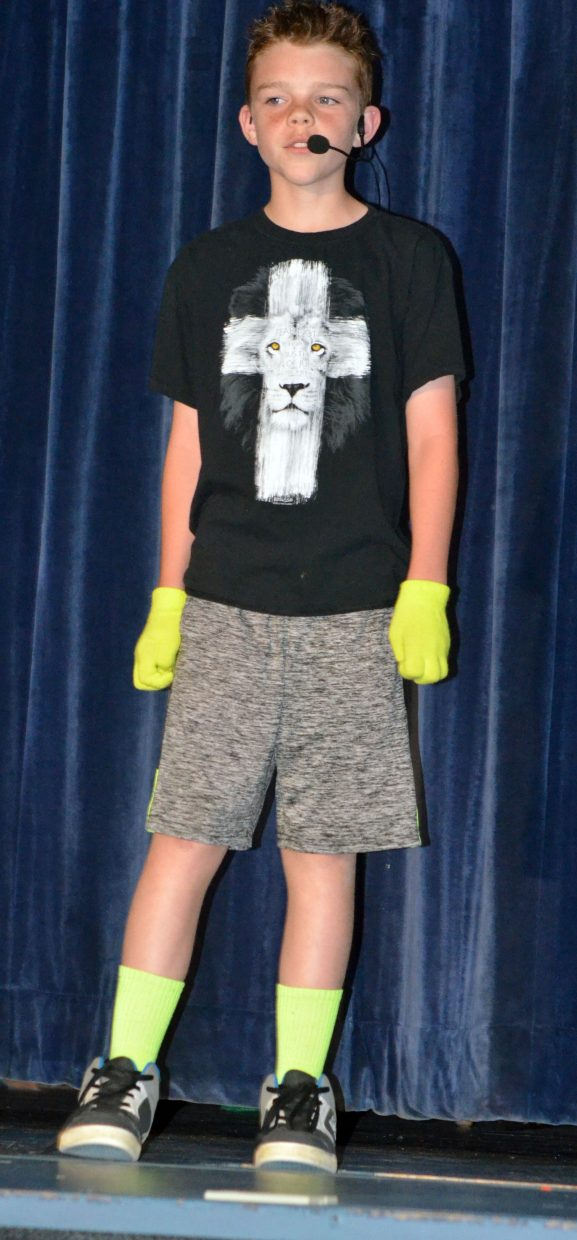 """Athan Smith sings """"In the Light"""" as part of Studio BV's vocal performance recital, """"Light Up the Stage"""" in the Craig Middle School auditorium."""