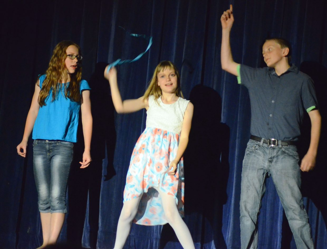 """From left, Jessica Womble, Shaylee Patterson and Logan Hafey get their feet moving as Womble sings """"Shake It Off"""" during Studio BV's vocal performance recital, """"Light Up the Stage"""" in the Craig Middle School auditorium."""