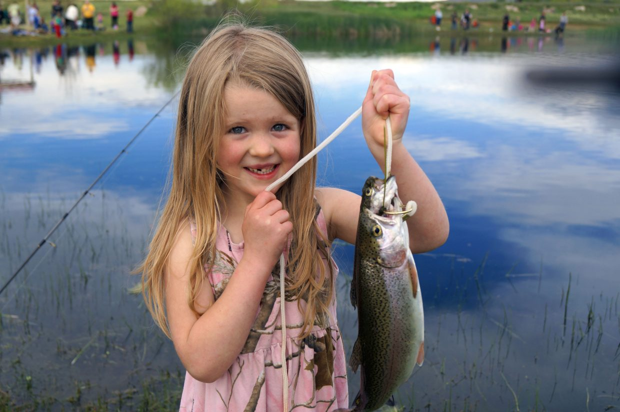 Cops vets and kids fishing day nets lots of fun for craig for Kids fishing net