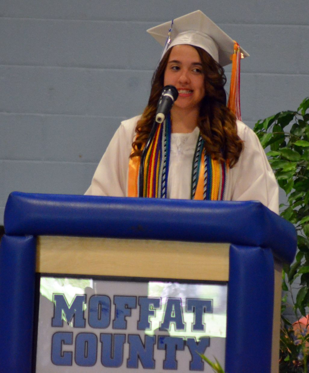 Moffat County High School graduating senior Sheyenne Cromer welcomes the crowd to the Class of 2016 graduation ceremony.