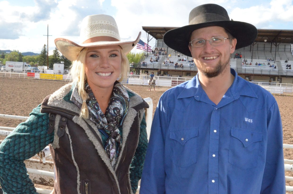 Bronc riding competitors Carly Ramsey and Wesley Rosengreen enjoy their respective titles as the winners of the Iron Woman and Iron Man Ranch Bronc Riding competitions at Grand Olde West Days. The two each racked up plenty of points Saturday to win.