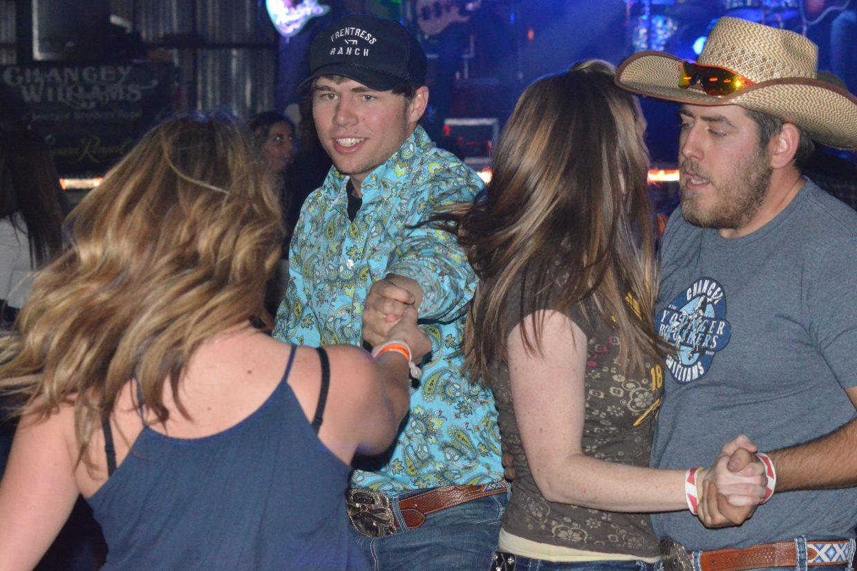 Audience members swing dance to the music of Chancey Williams & The Younger Brothers Band Saturday night at Moffat County Fairgrounds as part of Grand Olde West Days.