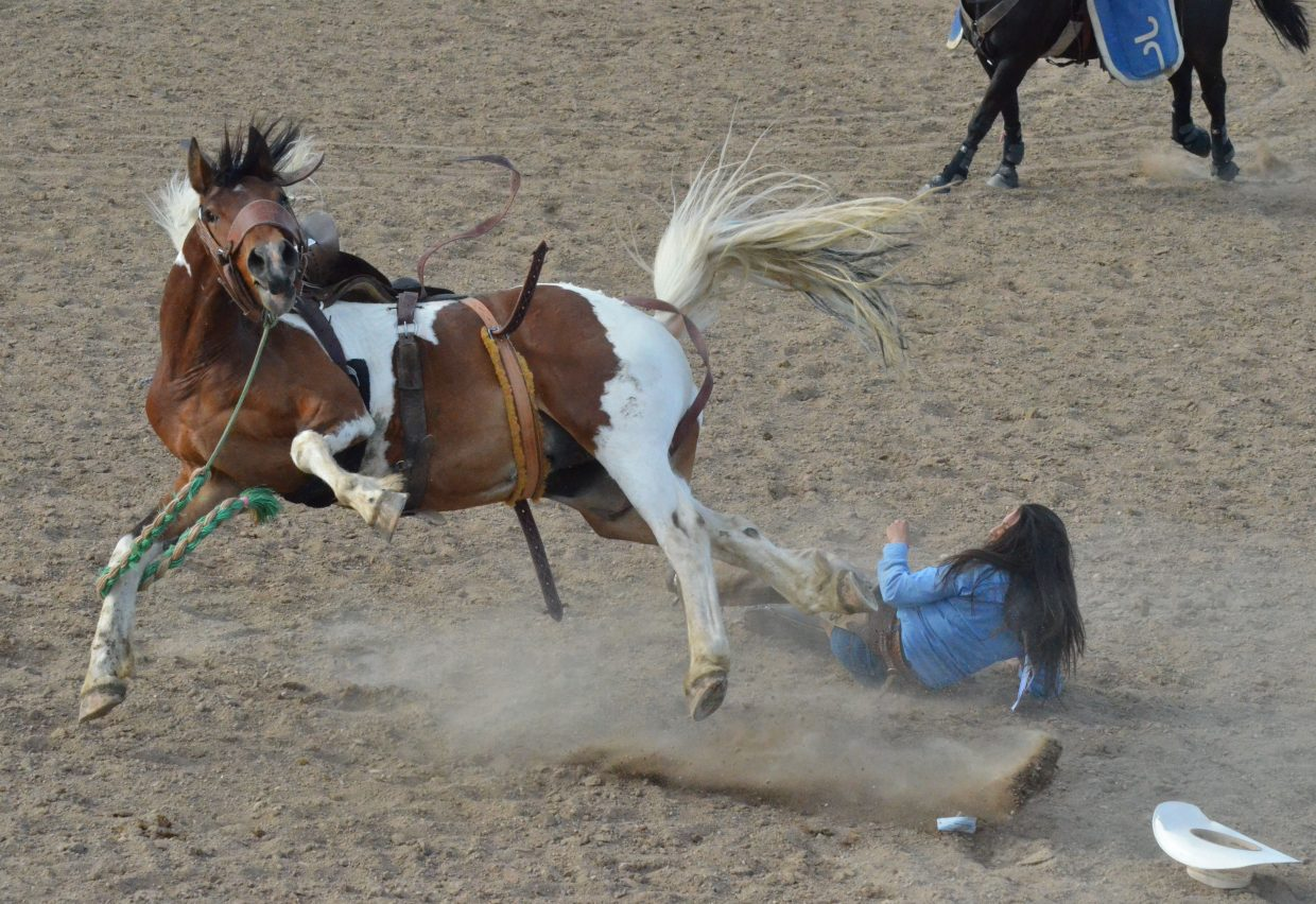 Jessica Saenz stays calm after being thrown from her horse as part of the Iron Woman Bronc Riding Invitational.