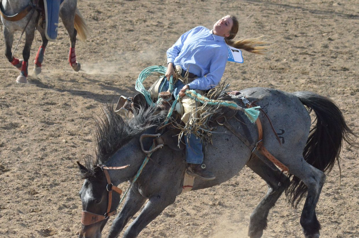 Brittany Miller keeps her position on top of her horse while competing in the Iron Woman Bronc Riding Invitational as part of Grand Olde West Days. Miller rode in both the Iron Man and Iron Woman events.