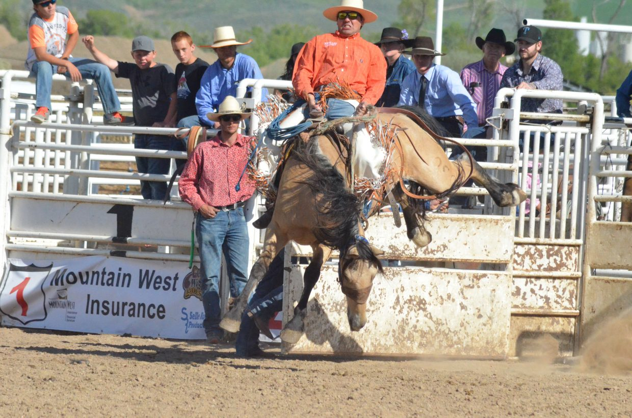 TeJay Fenster stays tough coming out of the gate during Saturday's Iron Man Ranch Bronc Riding during Grand Olde West Days.