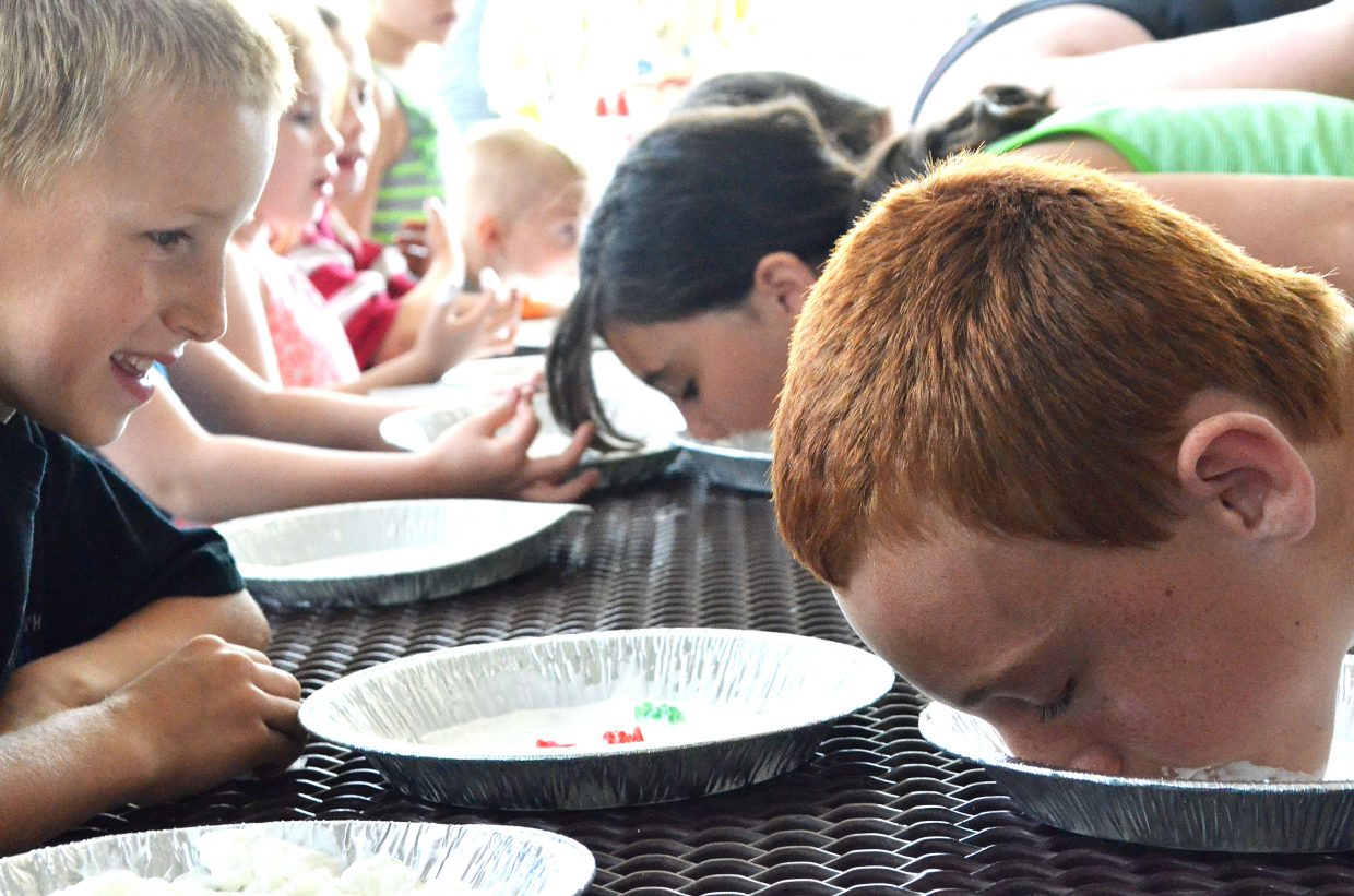 Children have messy fun Sunday, competing in a pie eating contest at Moffat County Fairgrounds during the Grand Olde West Days on Memorial Day weekend in Craig.