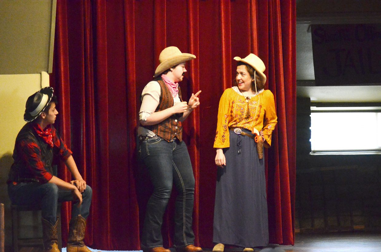 """Travis Johnston, who plays Deputy Bill Frick, and Faith Christiansen (Deputy Bob Frack), converse with Riley Johnston (Candy Cassidy) in the play """"An Old Craig Crime Spree."""""""