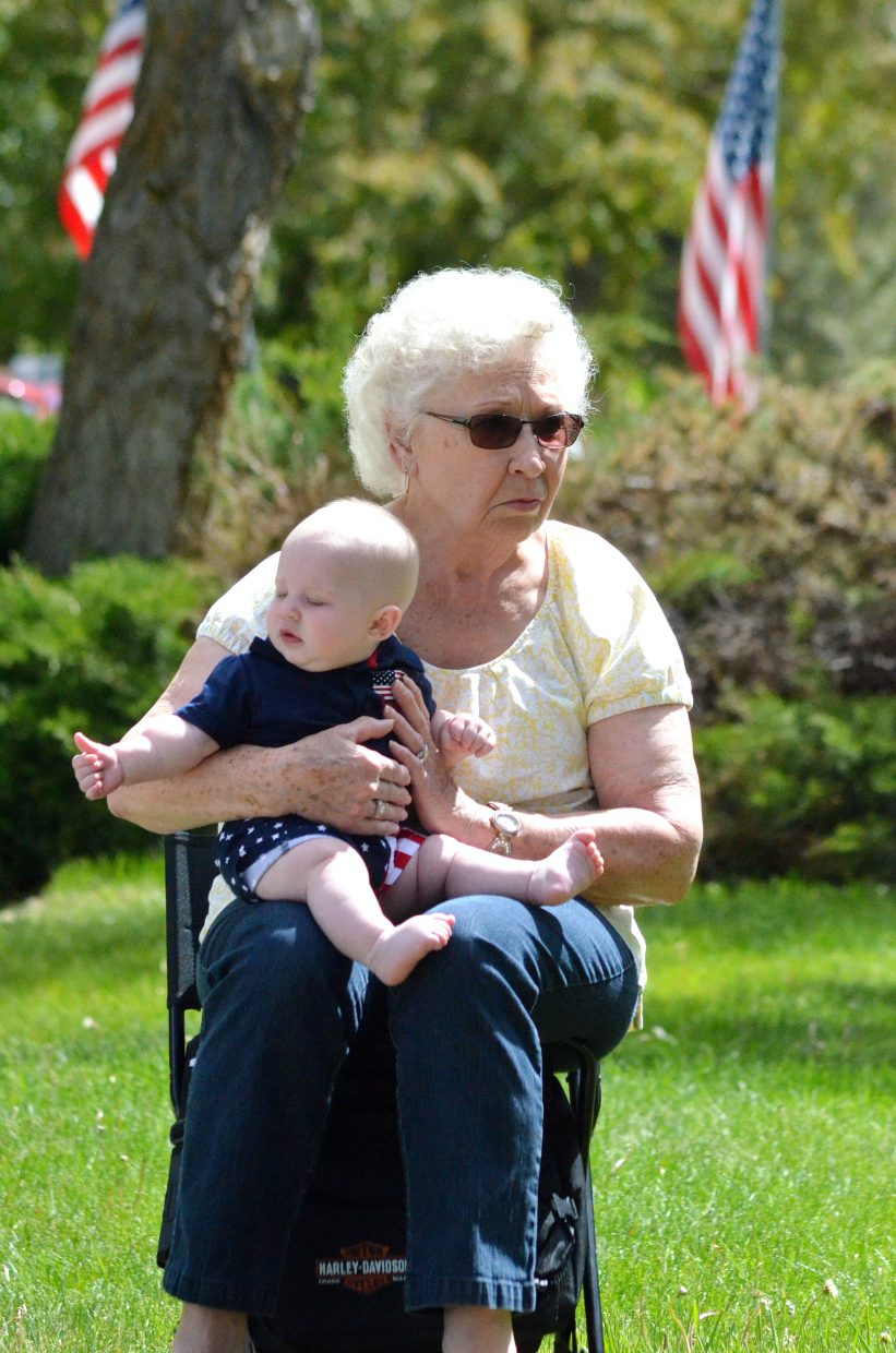 Darlene Chamberlain holds her great grandson, Kian Brookshire, who is 6 months old, at the Memorial Day ceremony at Craig Cemetery Monday morning. Chamberlain's husband, Ted Chamberlain, served in the Navy and fought in the Korean war. He passed away in 2010.