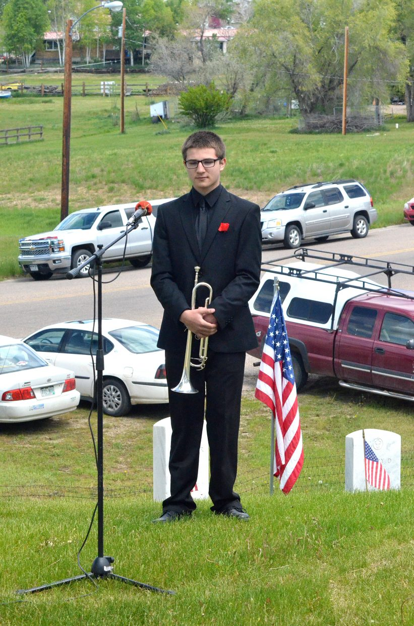 "Marcus Delgado, 16, prepares to play ""Taps"" at the Memorial Day ceremony held at Craig Cemetery Monday morning. Delgado is in the high school band and will be a junior in the fall."
