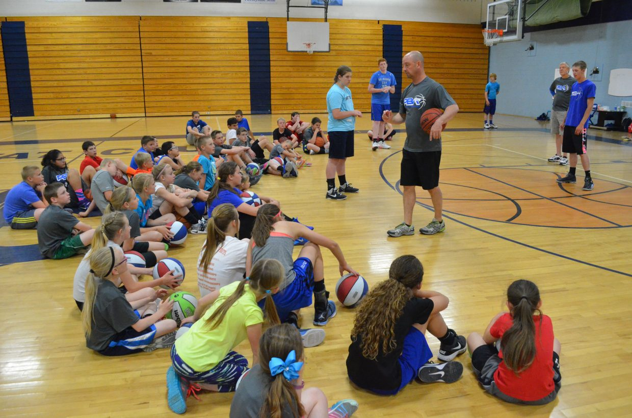Mike Moskowitz places players on the basketball court and details how to get into the right positions for participants of the Progressive Basketball Academy in the Moffat County High School gym. The three-day camp ran from Tuesday through Thursday for players in grades two through nine.