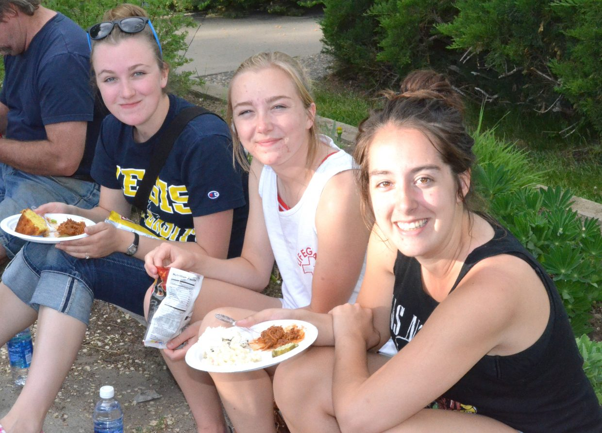 Locals partake in some food and enjoy the live music as part of Friday Fest and Dinner on the Avenue in Alice Pleasant Park.