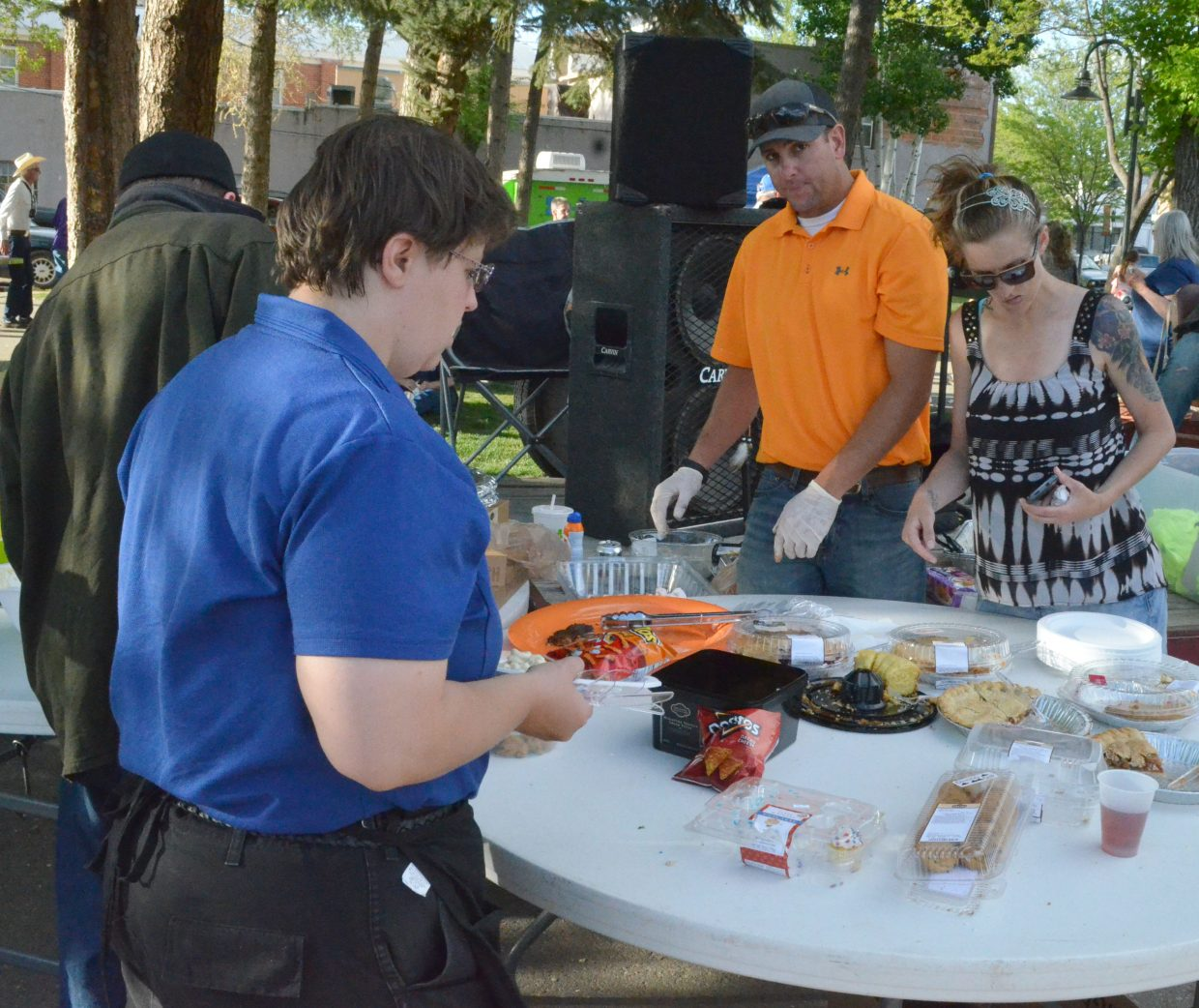 Members of Yampa Valley Young Professionals provide desserts and side dishes as part of Friday Fest and Dinner on the Avenue in Alice Pleasant Park.