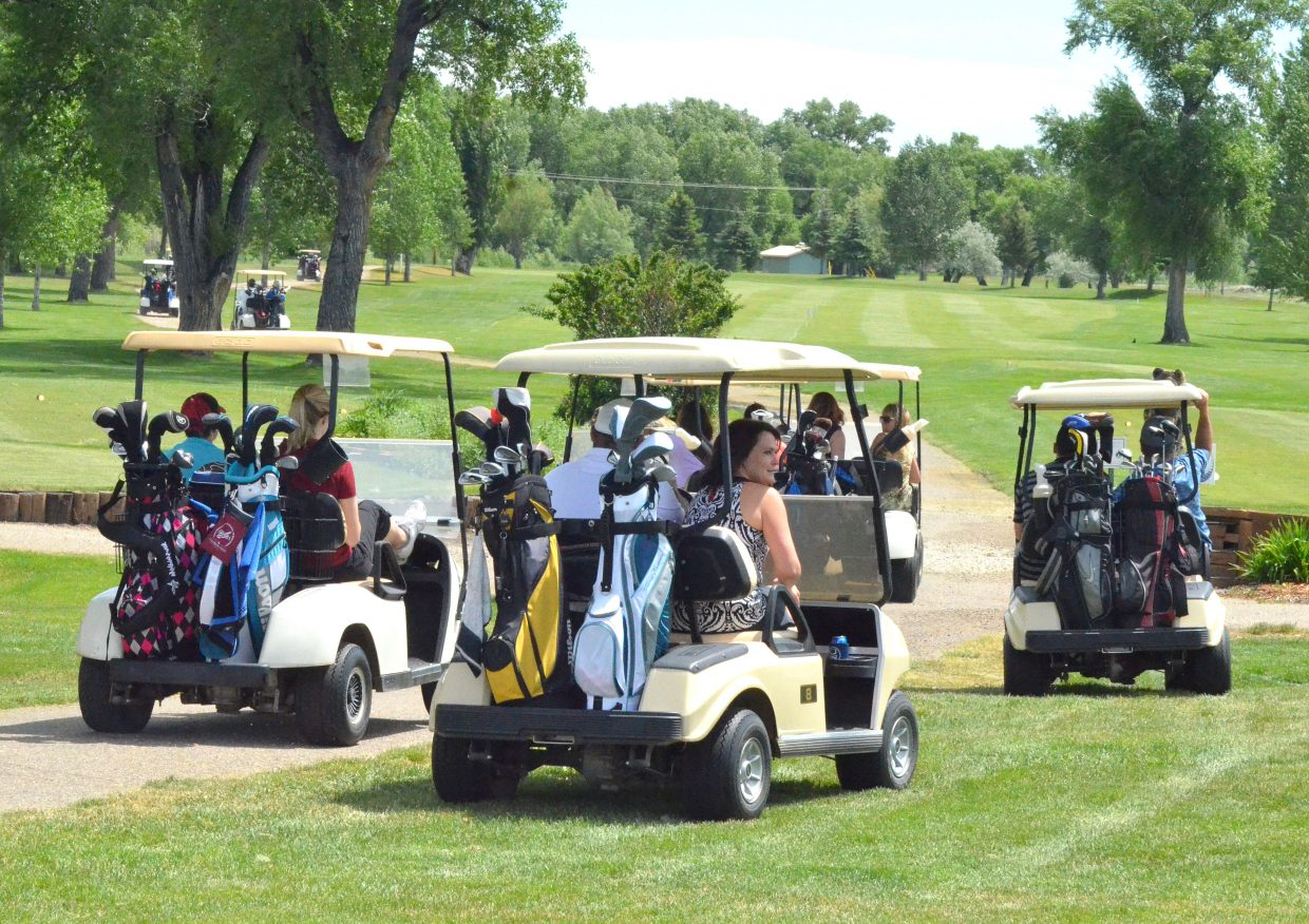 Players embark onto the paths of Yampa Valley Golf Course 2016s golf tournament hosted by Memorial Regional Health.