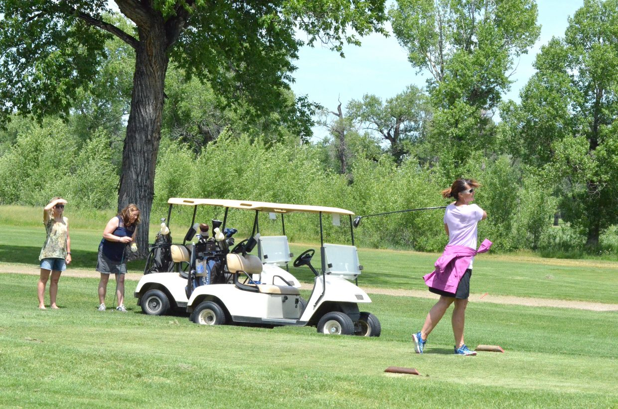 Terri Jourgensen hits her opening drive from the first tee box of Yampa Valley Golf Course Friday as part of The Memorial Hospital Foundation's golf tournament.