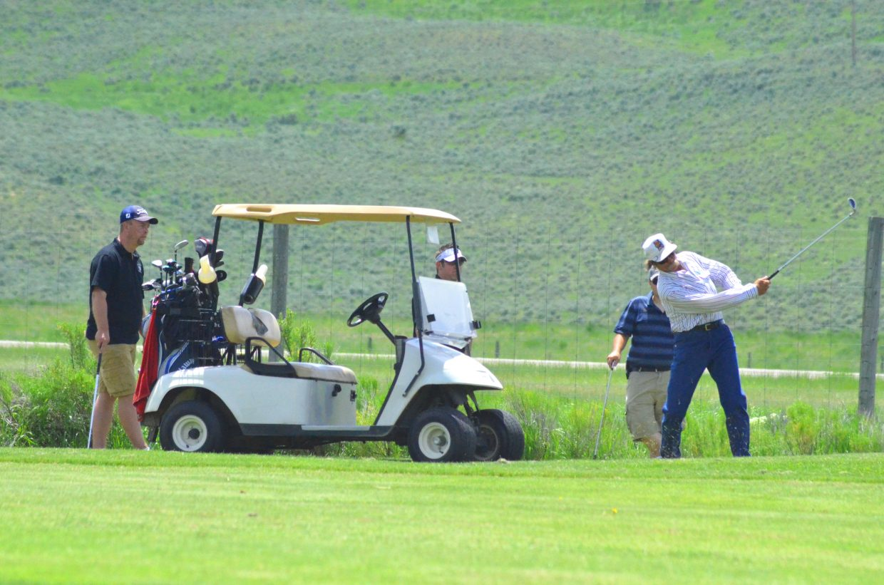 Players progress along the sixth fairway at Yampa Valley Golf Course Friday during The Memorial Hospital Foundation's golf tournament.