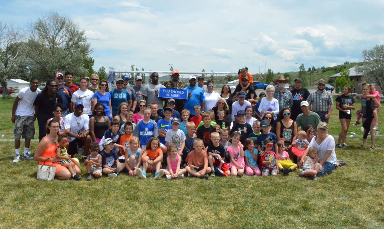 Community members gather on the fields of Loudy-Simpson Park following the NFL Play 60 Challenge, which featured instruction from numerous professional football players as part of the Victory Motors Cancer Drive. The Saturday event was a fundraiser full of family activities, including a 5K Color Run and appearances by Denver Broncos cheerleaders, to raise money for Moffat County Cancer Society.