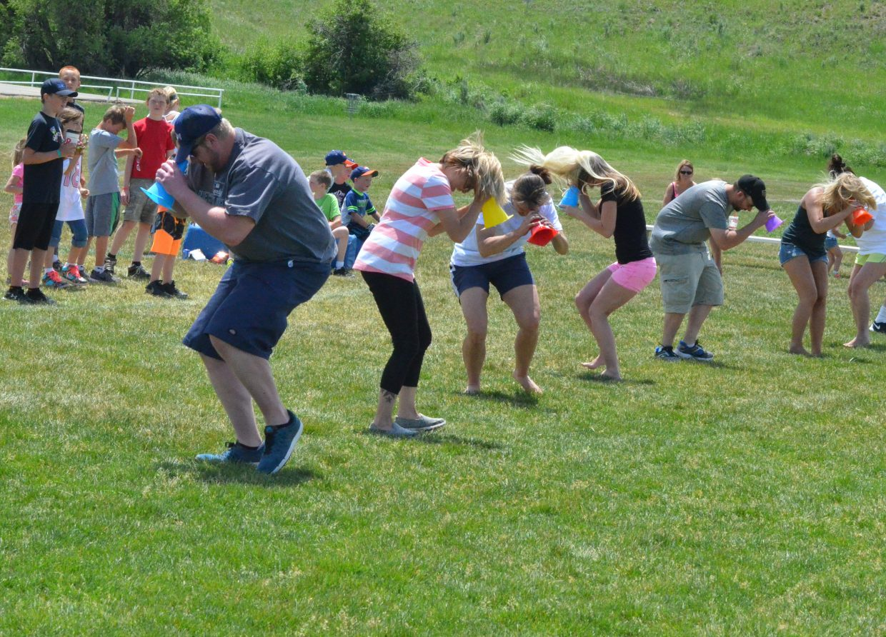 Adults get themselves good and dizzy and ready to run the field as part of the NFL Play 60 Challenge Saturday at Loudy-Simpson Park. Play 60 emphasizes physical activity for kids as well as parental involvement in their activities.