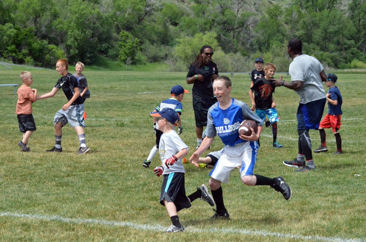 Participants in the NFL Play 60 Challenge stay on their feet for a game of tag Saturday at Loudy-Simpson Park as part of the Victory Motors Cancer Drive.