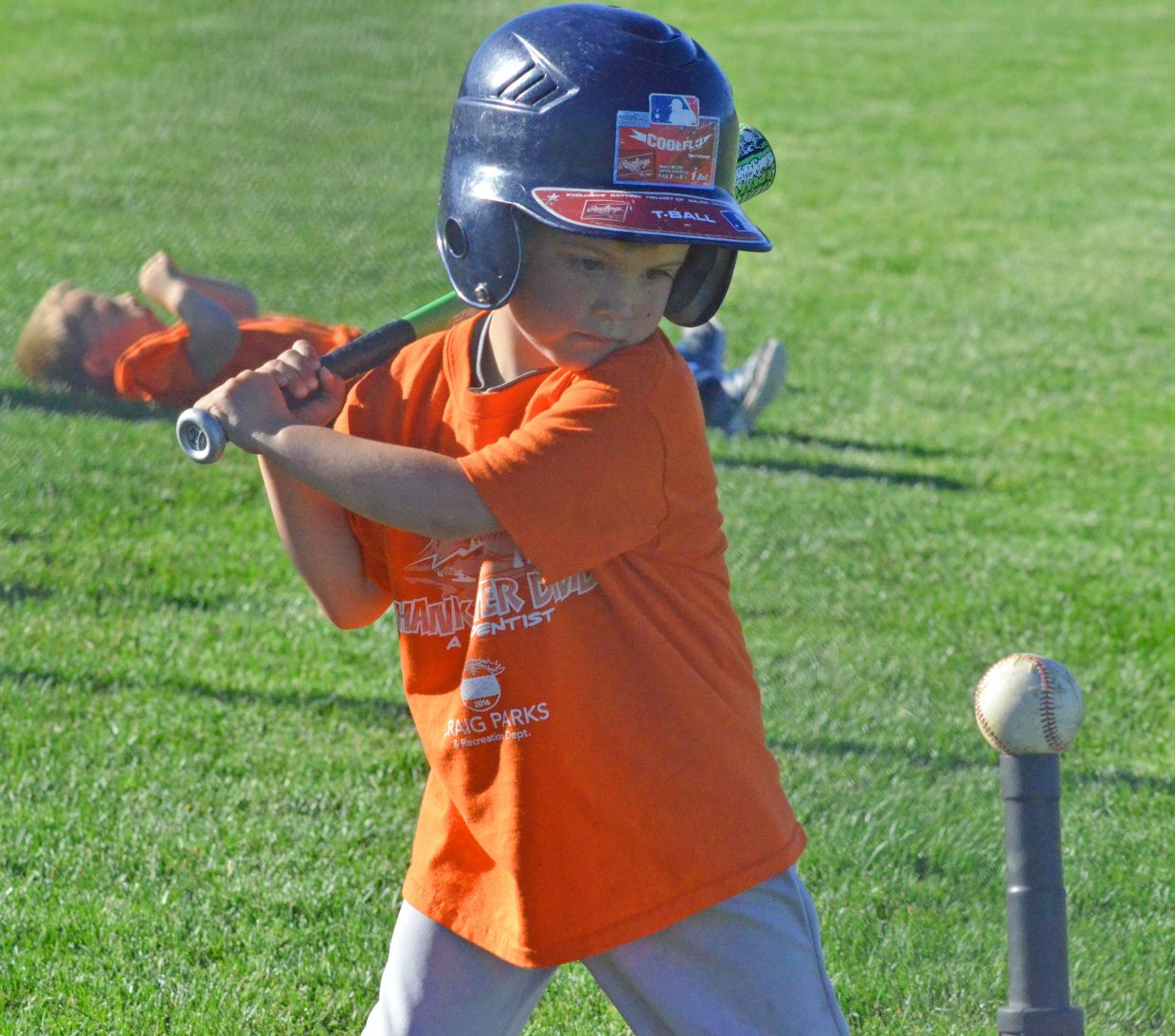 Chance Hixson eyes the ball and gets ready to swing during a Thursday Craig Parks & Recreation t-ball game at Woodbury Sports Complex. Hixson plays for the team A Kidz Dentist.