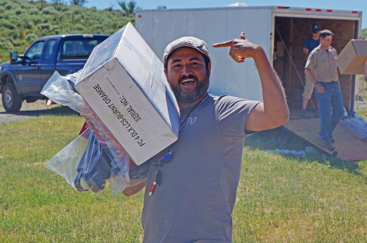 Mark Ybarra gets excited after winning a big prize — an inflatable chair-boat — in the final drawing.