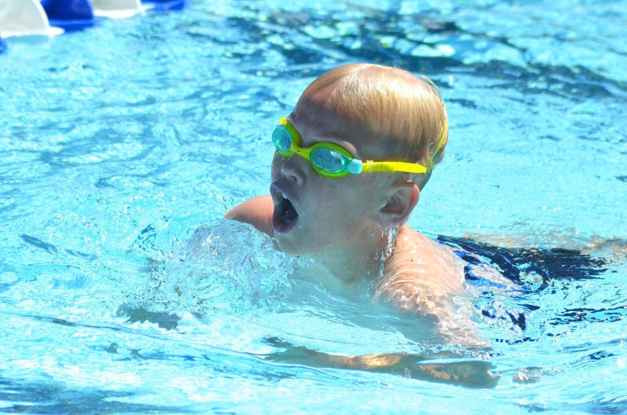 Patrick Neton gets a gulp of air in his lungs as he finishes his leg of the boys 200-meter medley relay at the Craig Sea Sharks' ABC Meet Saturday morning at the Craig City Pool Complex.