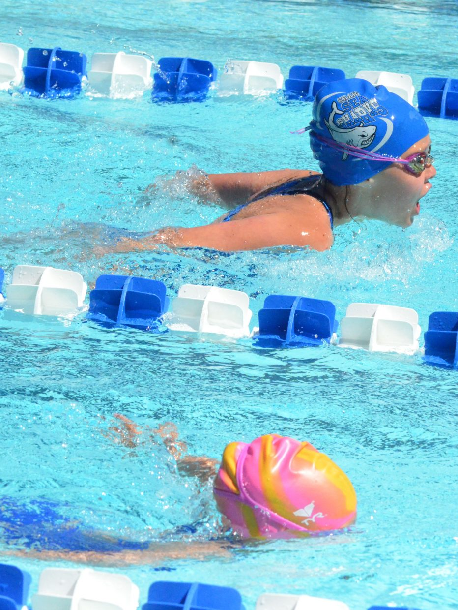 Megan Neton gets ahead of the competition during the girls 200-meter medley relay at the Craig Sea Sharks' ABC Meet Saturday morning at the Craig City Pool Complex.