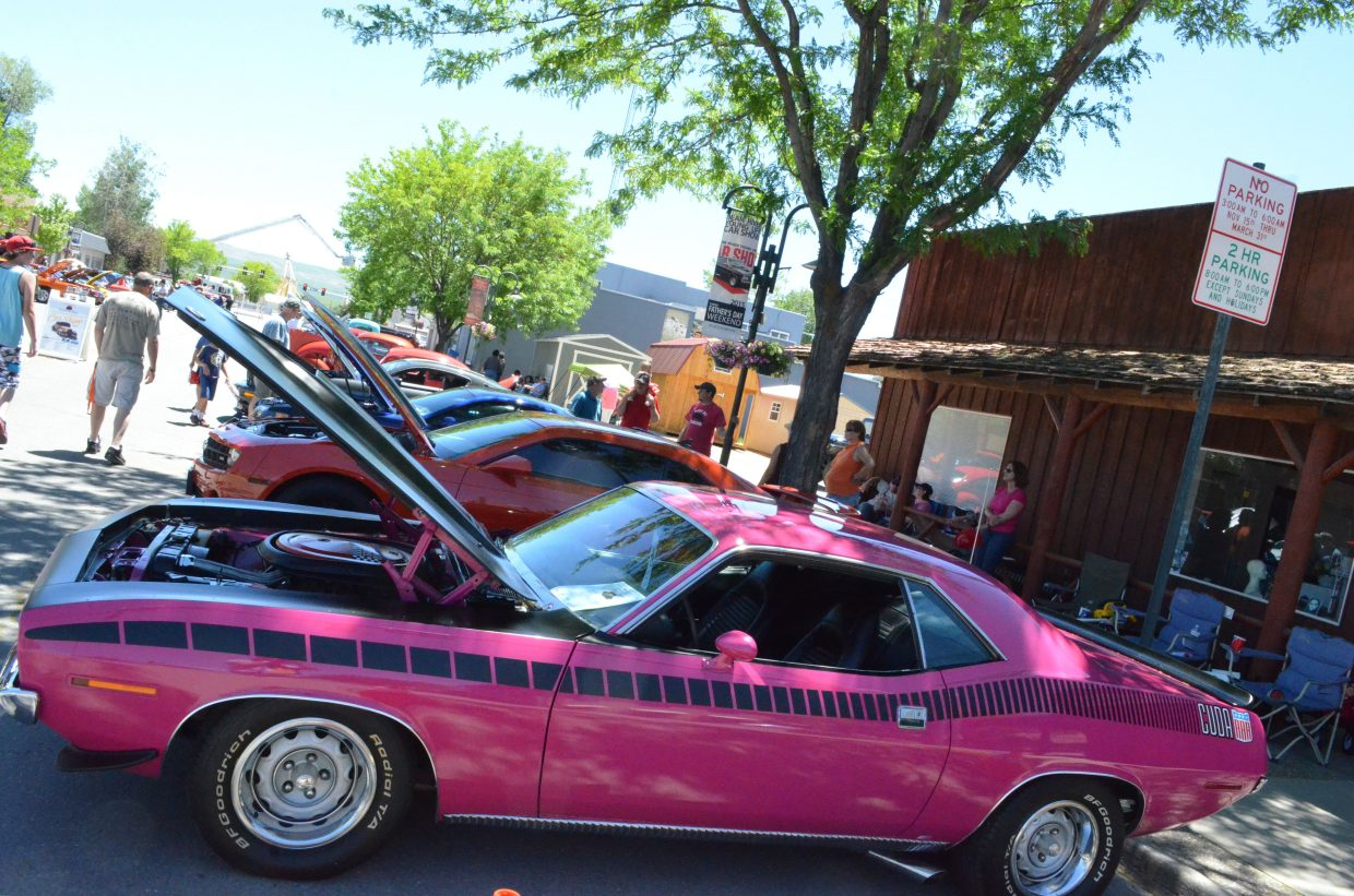"""Patrons view the classic autos along Yampa Avenue as part of the Bear River Young Life Car Show and Fundraiser Saturday afternoon, many vehicles ironically situated next to """"No Parking"""" signs."""