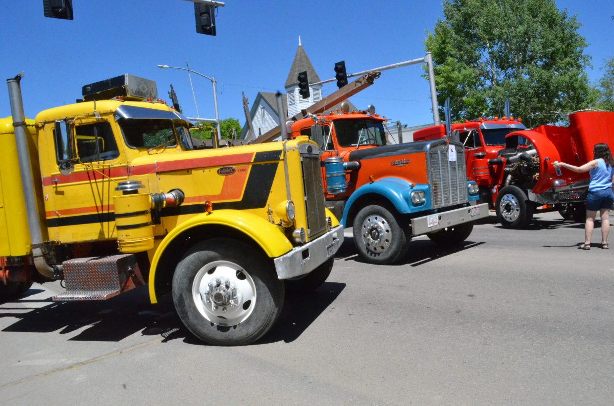 A blockade of big rigs sit at the end of the 500 block of Yampa Avenue as part of the Bear River Young Life Car Show and Fundraiser Saturday afternoon in downtown Craig.