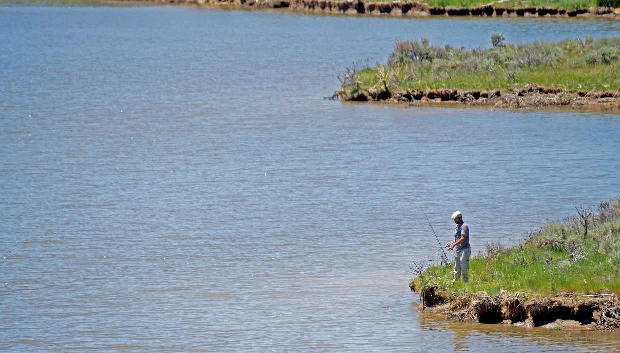 Mark Ybarra, one of the top prize winners at the end of the tournament, fishes from shore on Sunday.