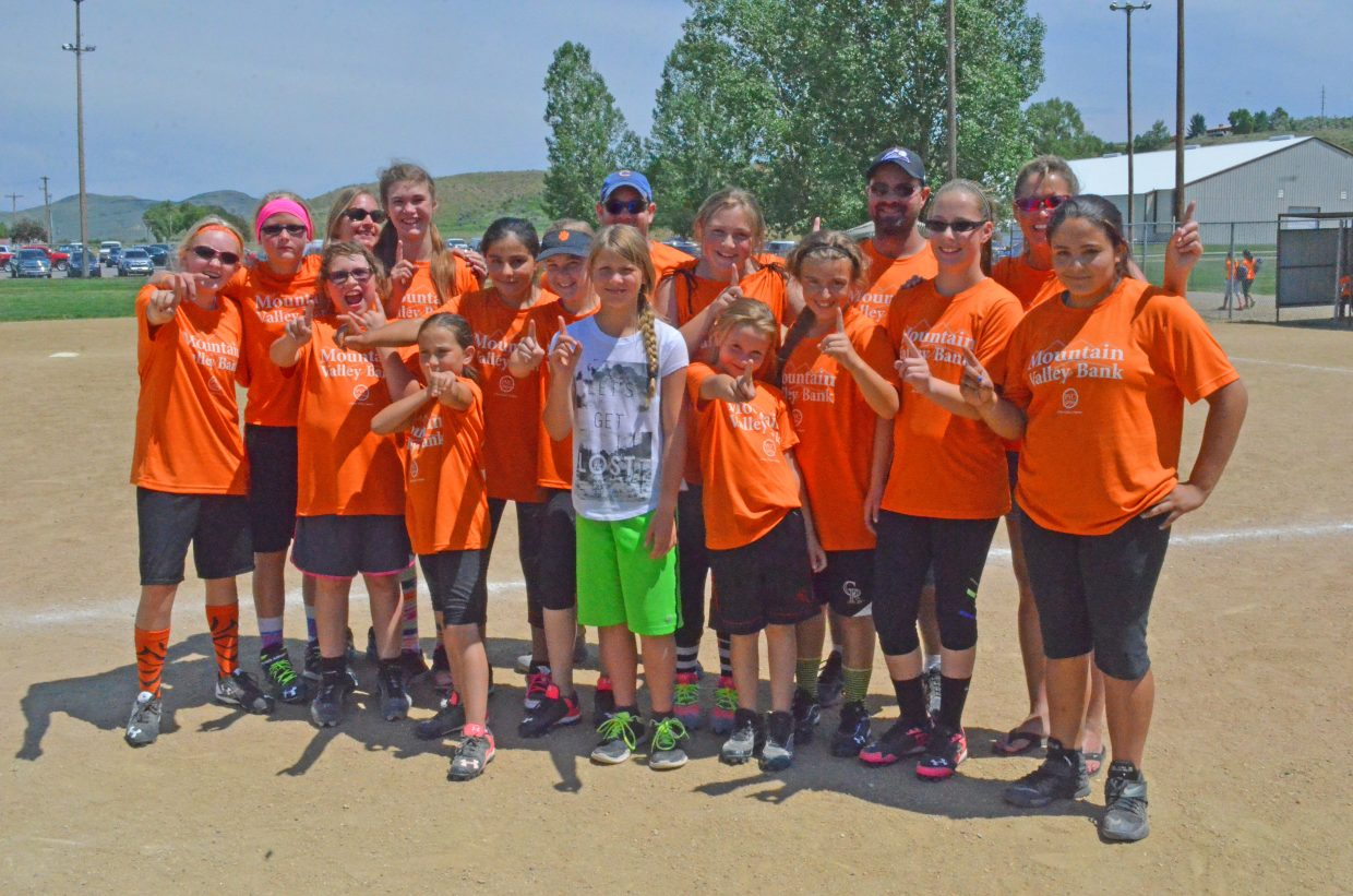The players and coaches of Hayden's Mountain Valley Bank celebrate their championship victory Thursday at Craig's Loudy-Simpson Park as part of the 8 to 12-year-old slow pitch softball league for Craig Parks & Recreation. Hayden defeated Cook Chevrolet-Cook Ford, 10-5, in the final game. Back row, from left: LeeAnna Nelson, Alison Rajzer, coach Anna Davis, Jillian Bennett, coach Jerry Davis, Piper Jo Jones, coach Jarrod Hampton, coach Tracey Munden. Front row: Dakota Munden, Brianna Brady, Luzmia Verastica, Tessa Booco, bat girl Emily Rajzer, Alex Hampton, Kobe Hampton, Aveory Lighthizer, Kimberly Verastica. Not pictured: Alexis Brown.