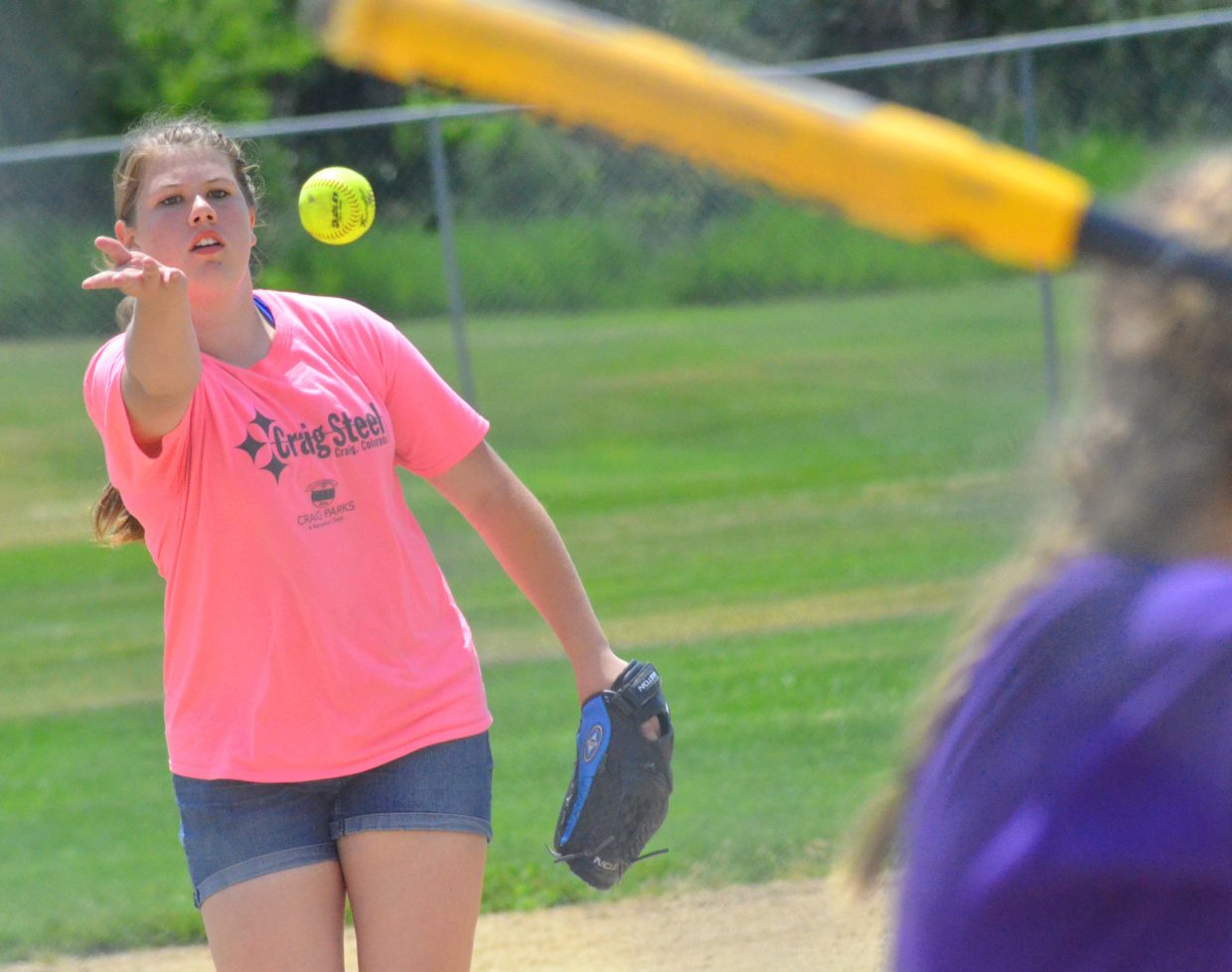 Hailee Herndon pitches for Craig Steel during the championship game of the girls 13- to 18-year-old slow pitch softball league for Craig Parks & Recreation.