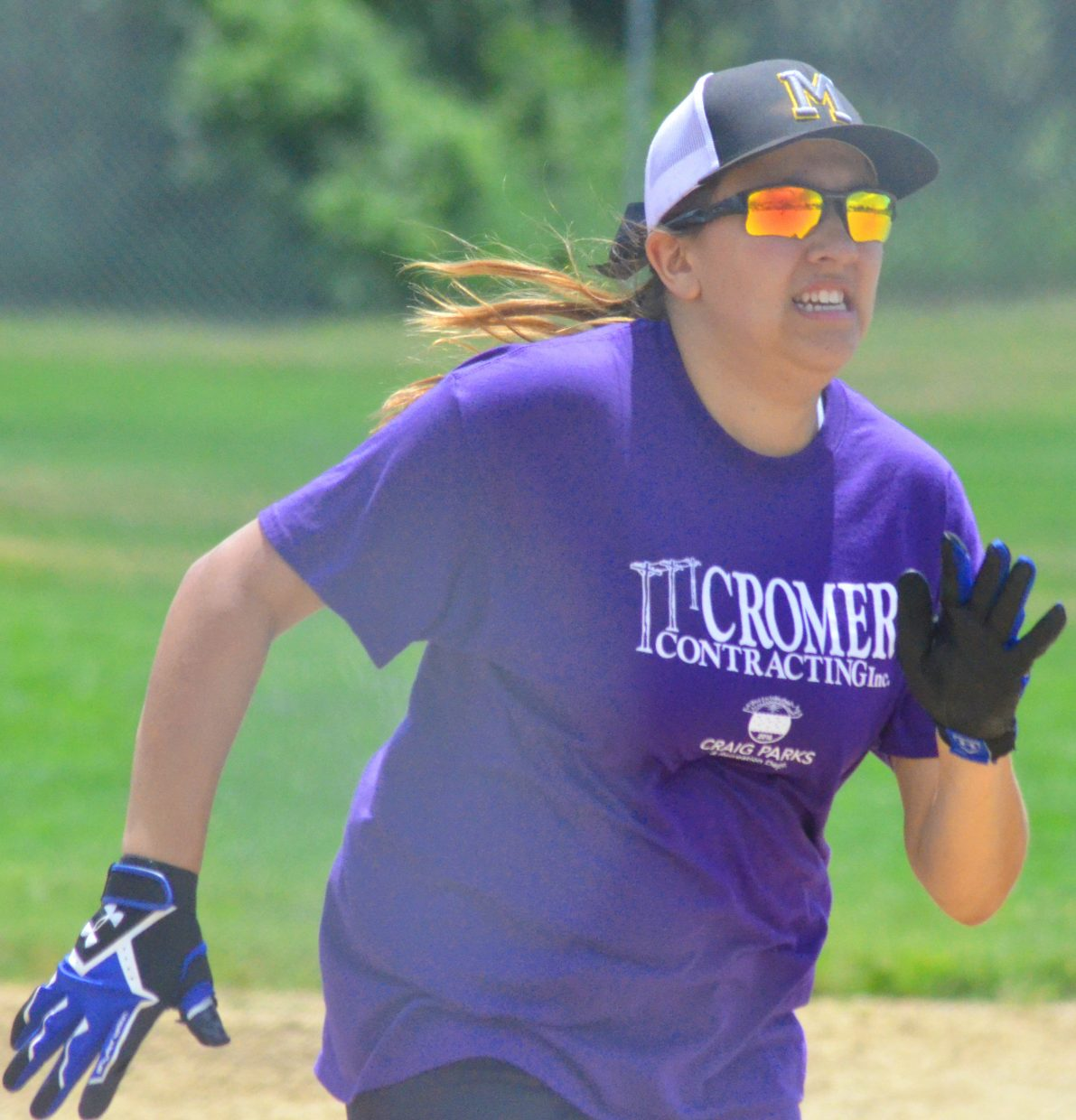 Sheyenne Cromer, of Cromer Contracting, speeds to home plate during the championship game of the girls 13- to 18-year-old slow pitch softball league for Craig Parks & Recreation.