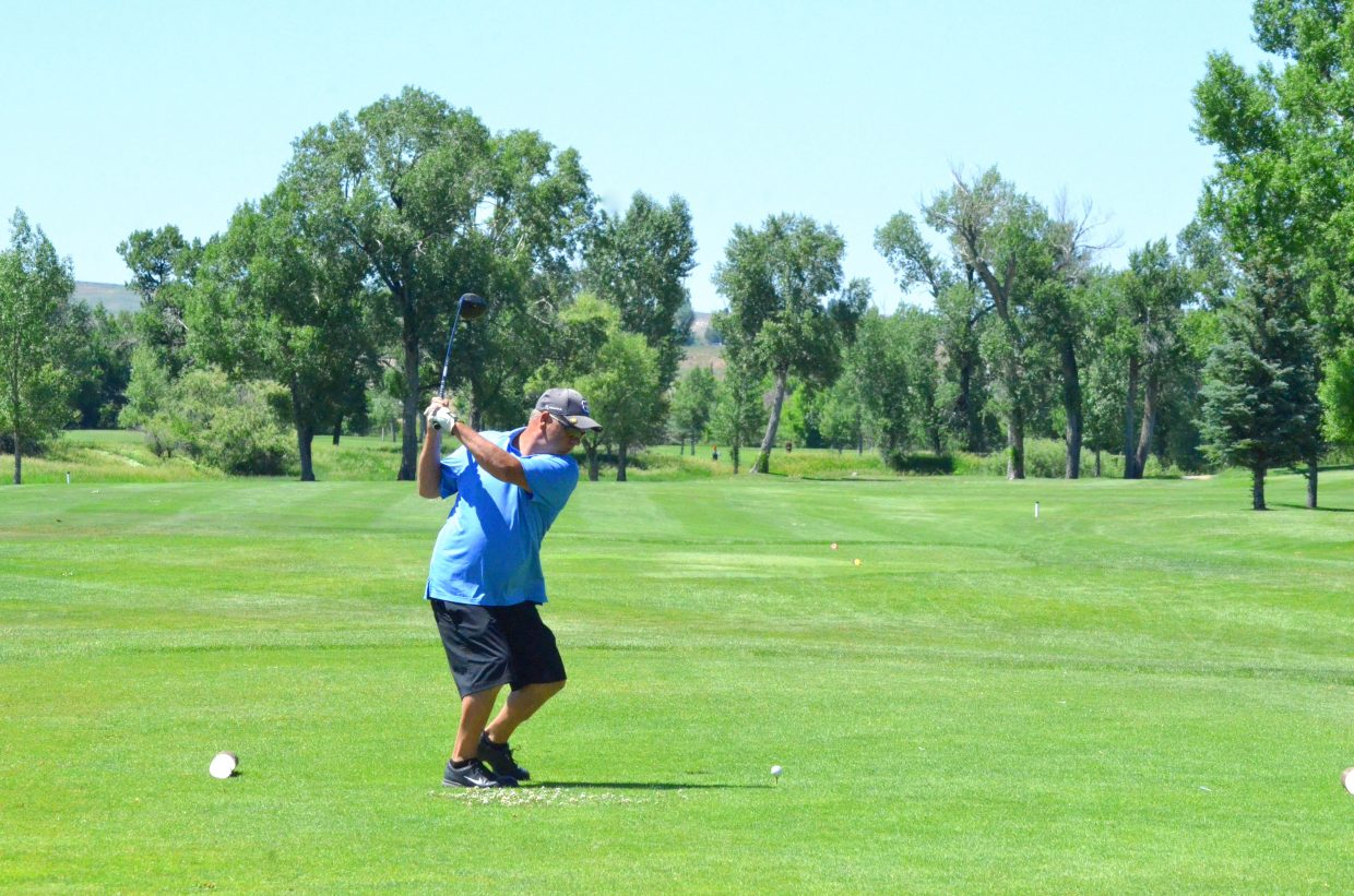 Mike Main goes into his backswing on the the 10th tee box of Yampa Valley Golf Course during the 49th annual Cottonwood Classic.