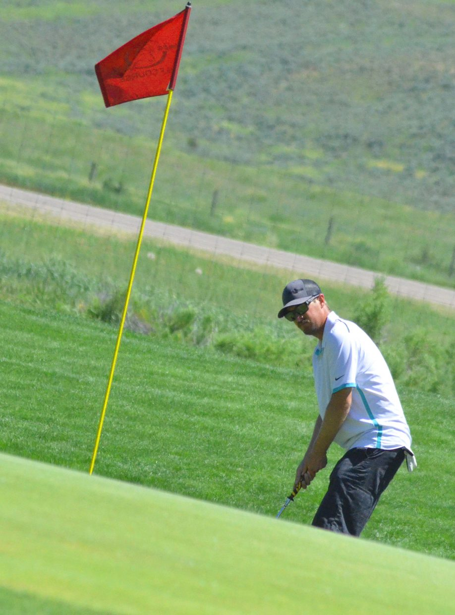Brett Konkel eyes a possible chip onto the sixth green of Yampa Valley Golf Course during the 49th annual Cottonwood Classic.