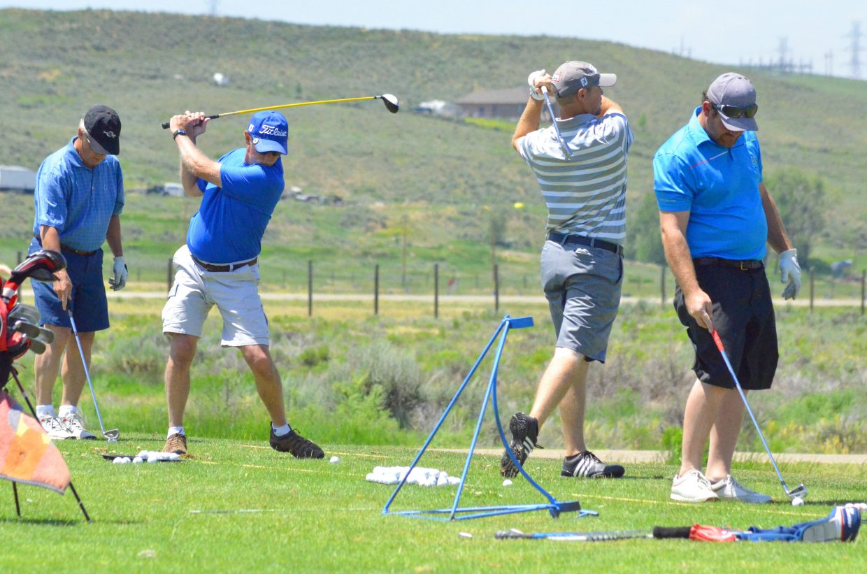 Players in the 49th annual Cottonwood Classic get warmed up on the driving range as they await their official tee times Friday to start the tournament.
