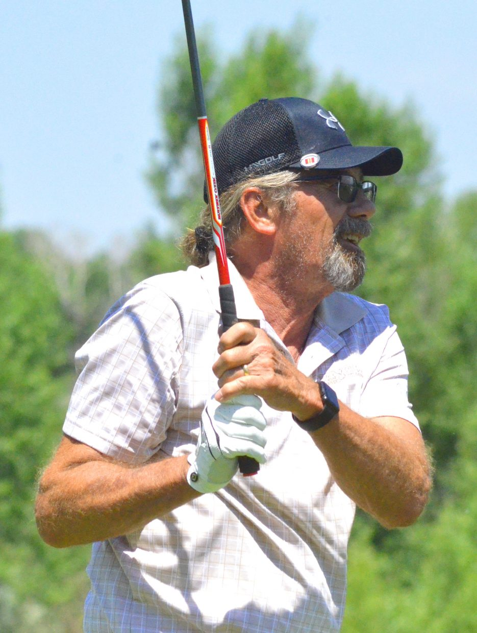 Doug White takes a moment to follow his drive on the 13th tee box of Yampa Valley Golf Course during the 49th annual Cottonwood Classic.