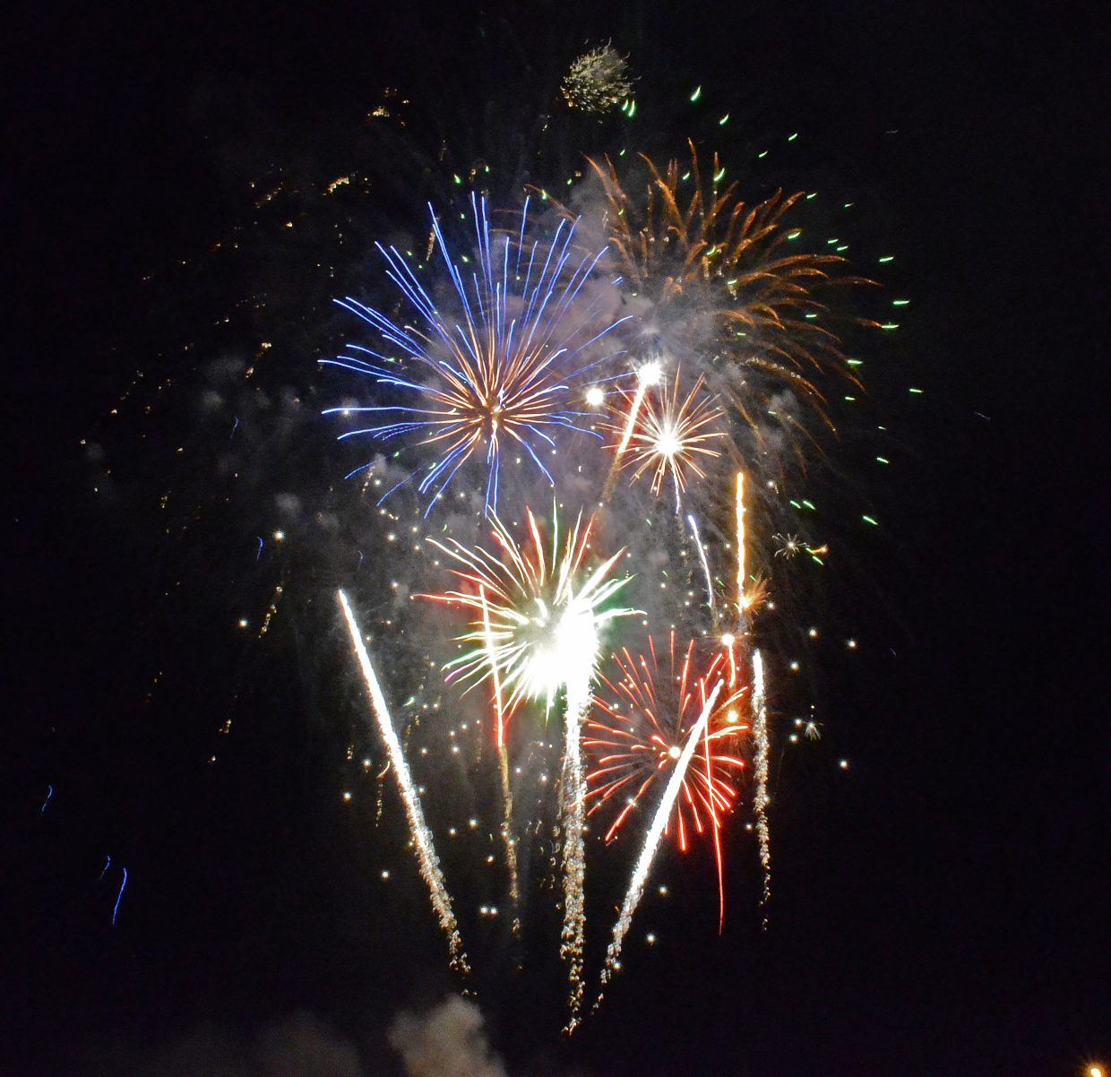 Fireworks light up the night sky on the Fourth of July.  This year, the city and county each contributed $3,000 and the fire department $2,000 for the fireworks, he said. The resulting $8,000 bought 1,532 shells from Wyoming supplier Flying Phoenix.