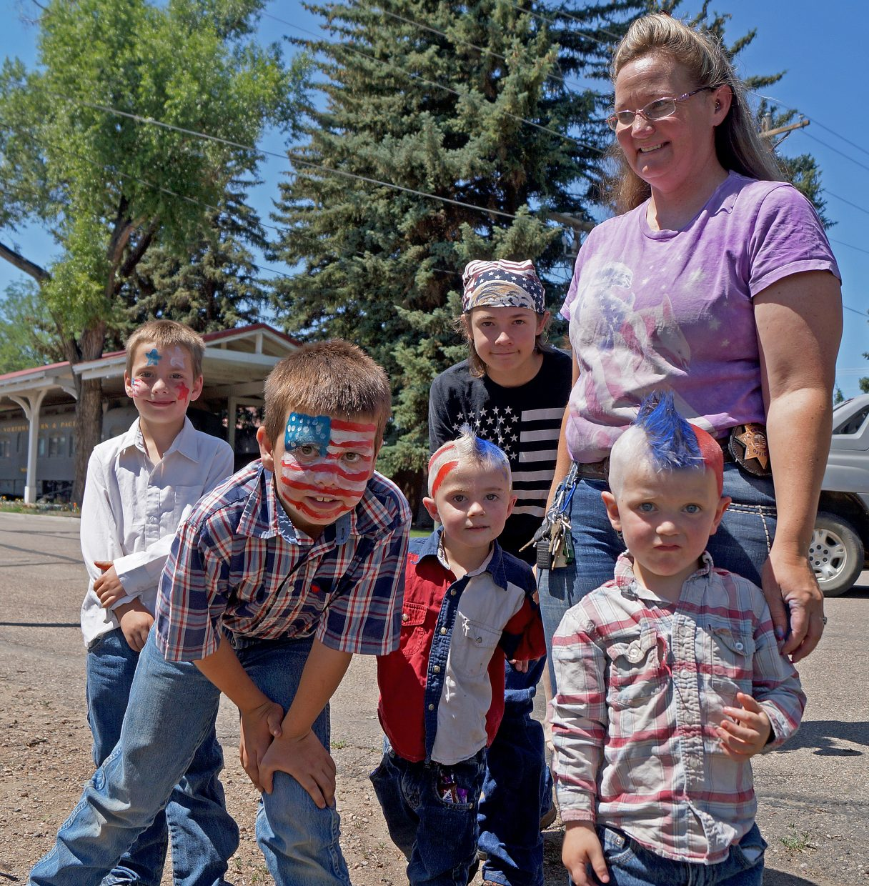 Jauneth Madsen's boys Treyton Nottingham, 8; James Nottingham, 10; Brandon Madsen, 14; Xavier Madsen. 3; and Pete Madsen show off their patriotic getups in honor of Independence Day.