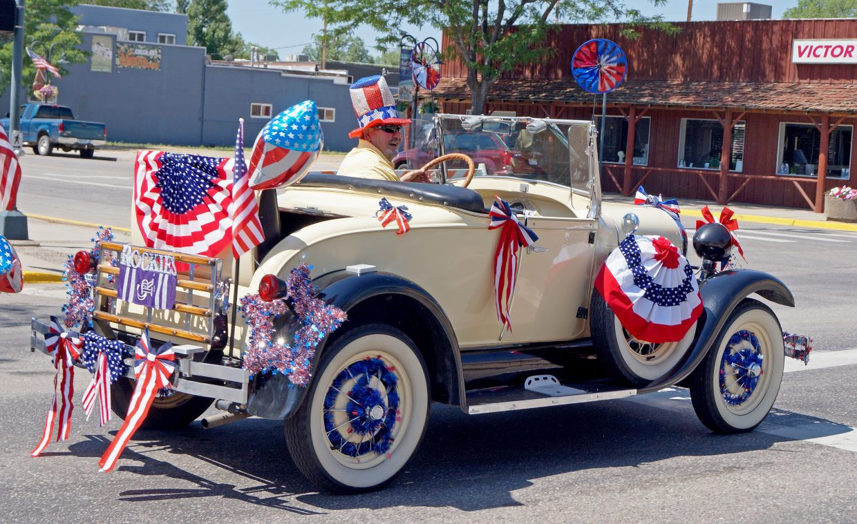 A classic car sits at Victory Way and Yampa Avenue as part of the Fourth of July procession through town.