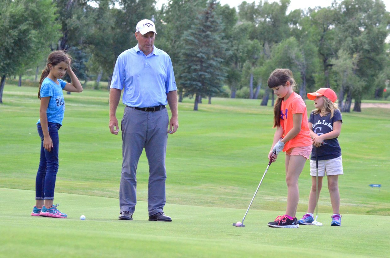 Bob Mueller, Yampa Valley Golf Course professional, provides advice for young golfers Chloe Whitaker, left, 10, Joslyn Curtis, right, 7, and Ila Muhme, 7, far right, as they look to close out their day on the ninth green of YVGC. Mueller had 28 Craig kids participate in six weeks of sessions with PGA Junior Golf Academy, a final exhibition taking place Tuesday.
