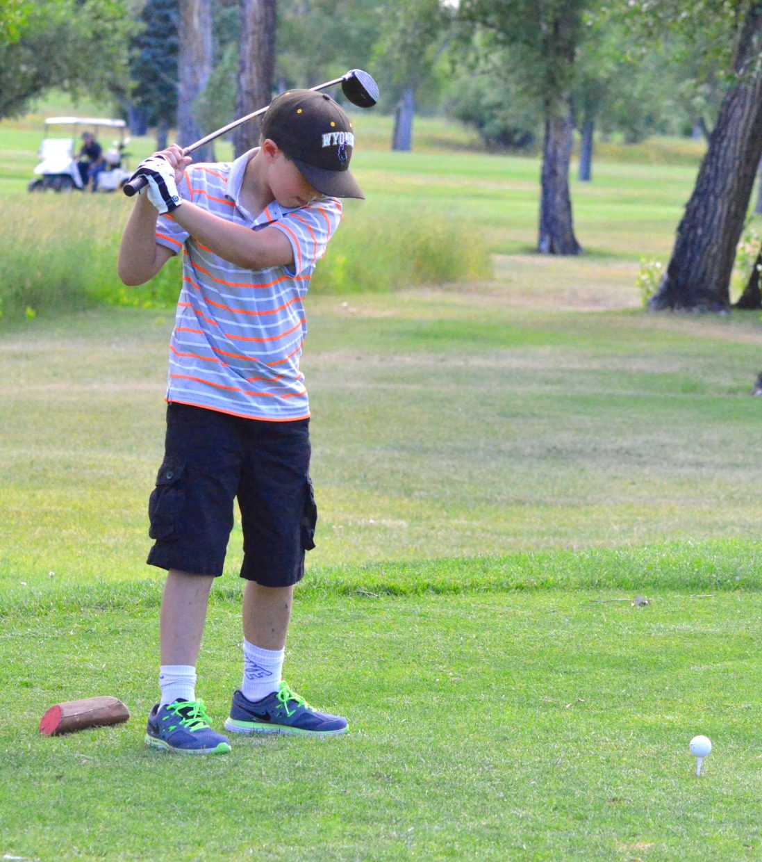 William Geis, 9, goes into his backswing on the eighth tee box of Yampa Valley Golf Course.