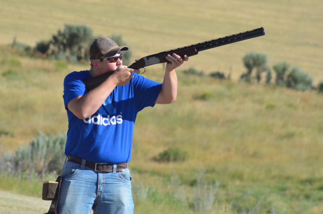 Moffat County shooter Jesse Earle takes aim and gets ready to fire during the 4-H shotgun completion shoot Saturday at Craig Trap Club. The group will send senior and junior teams, each including five shooters and one alternate, to the state competition in September in Colorado Springs.