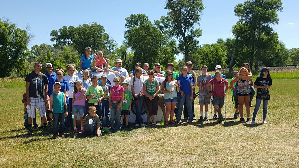 Competitors in the Moffat County archery team gather at Wyman Living History Museum.