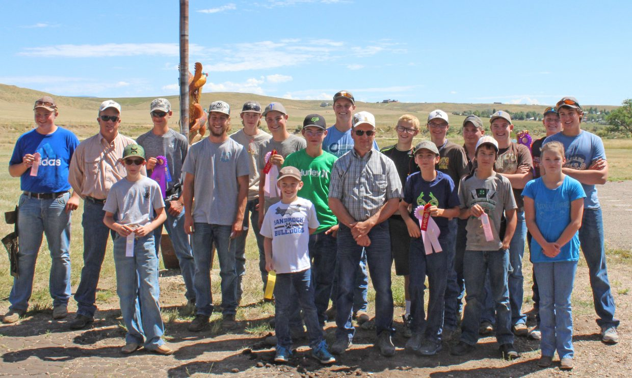 Members and coaches of the Moffat County shotgun team gather at Craig Trap Club following the Saturday completion shoot.
