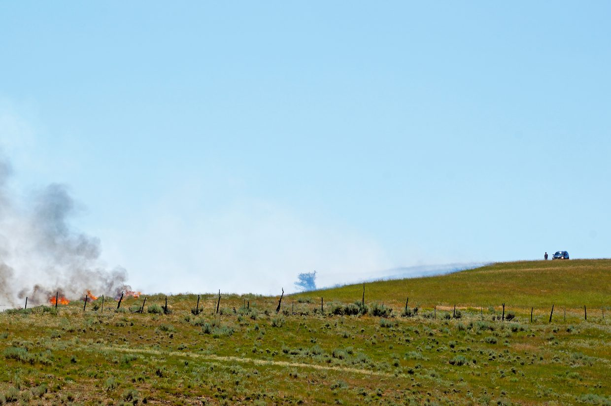 First responders arrive on scene at a wildland fire near Elkhead Reservoir on Wednesday afternoon.