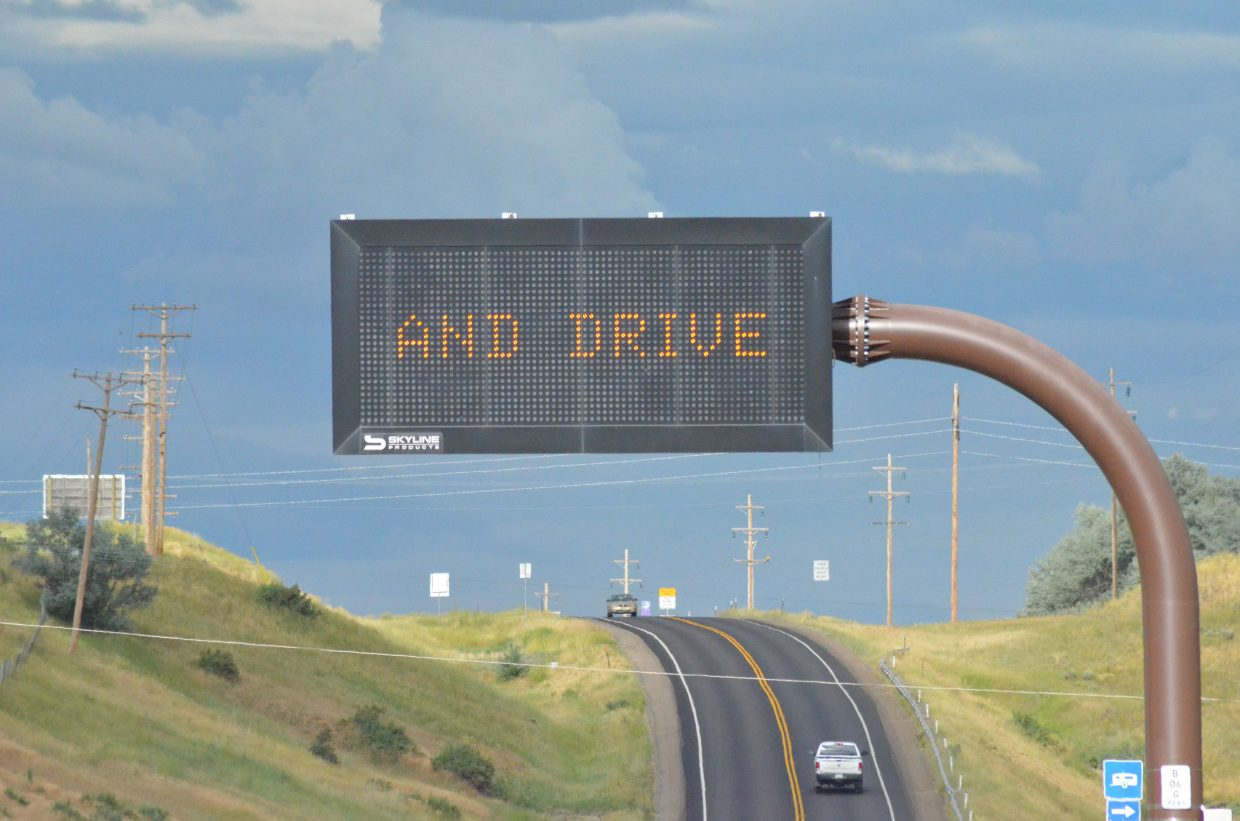 "A sign on Highway 40 reminds drivers of the danger of distracted driving, including playing the video game ""Pokémon GO."""